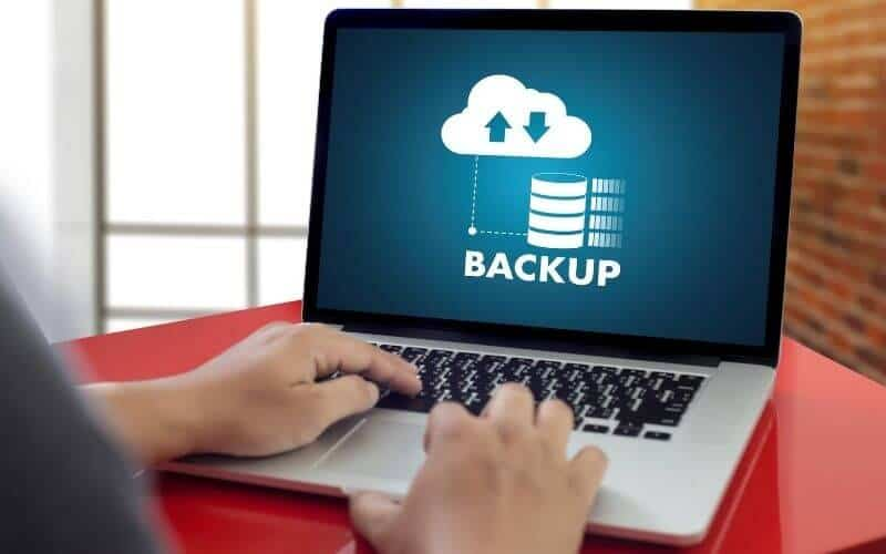 Someone backing up their data to a cloud service